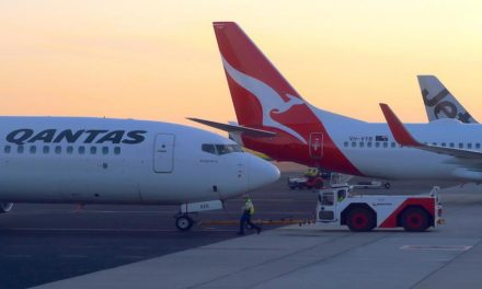 Qantas records thumping loss
